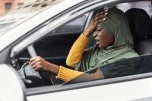 driving-anxiety-stressed-black-muslim-lady-in-hija-U38CK7M